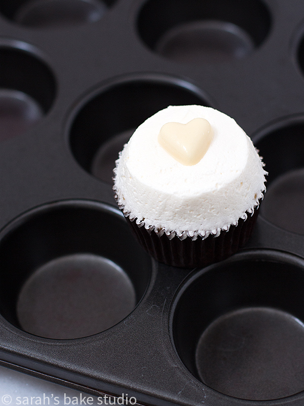Very Banana Cupcakes - doctored white cake mix and bananas baked into a delicious, moist and airy cupcake, and topped with a dollop of vanilla buttercream; your favorite VERY banana cupcakes!