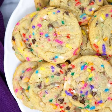 an up close look at chocolate chip cake batter cookies on a plate