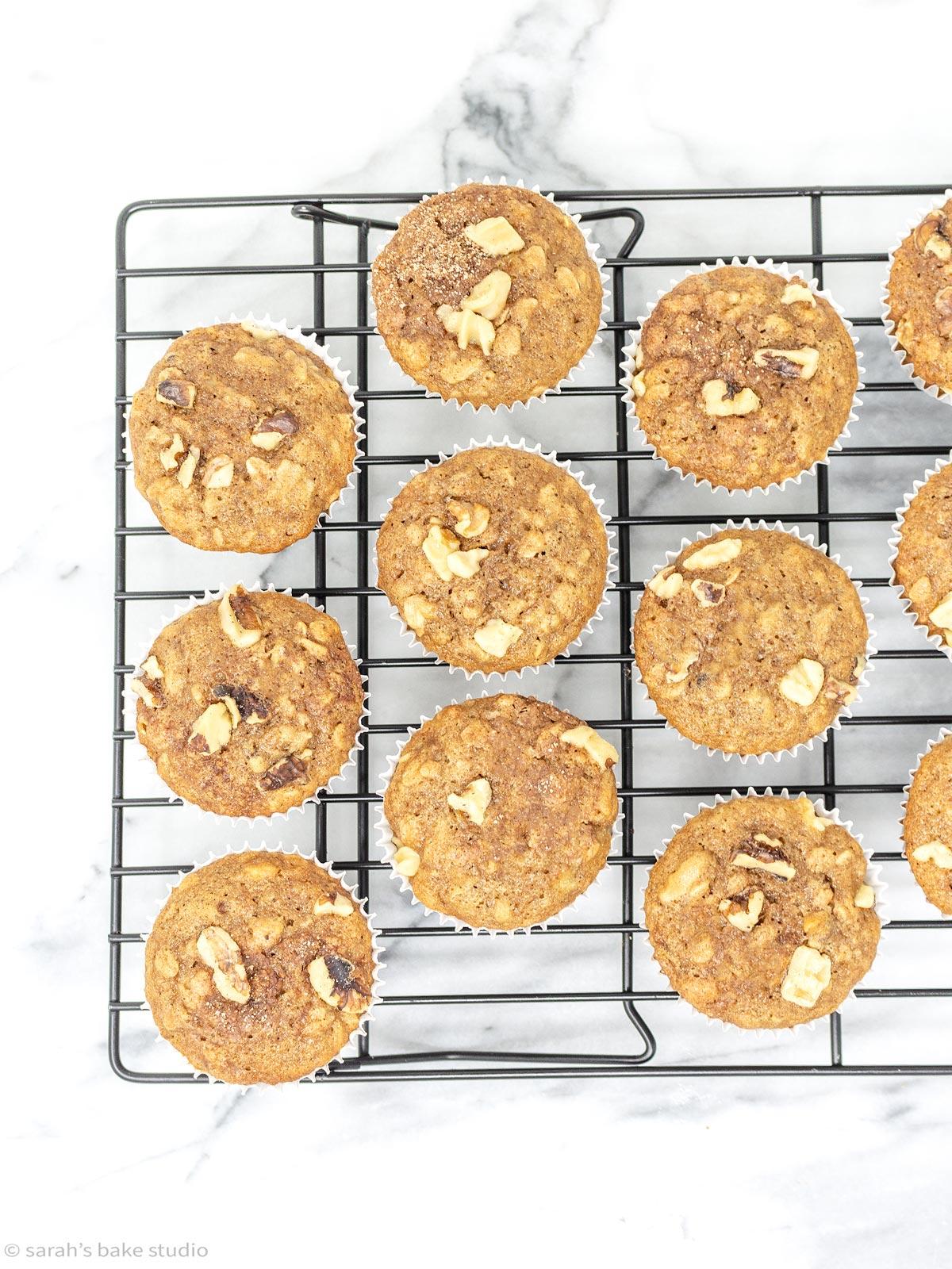 a flat-lay of banana walnut oatmeal muffins on a cooling rack.