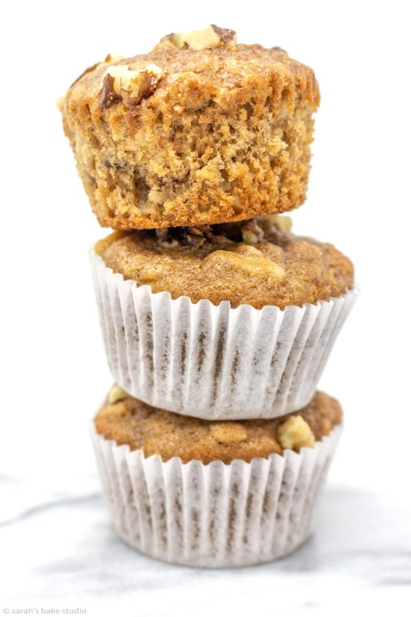 Soft and moist banana nut muffins jam-packed with bananas, oats, and walnuts with a sweet hint of cinnamon make these scrumptious muffins perfect for breakfast or a snack.