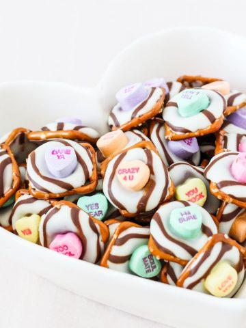 conversation heart pretzel hugs in a heart shaped bowl