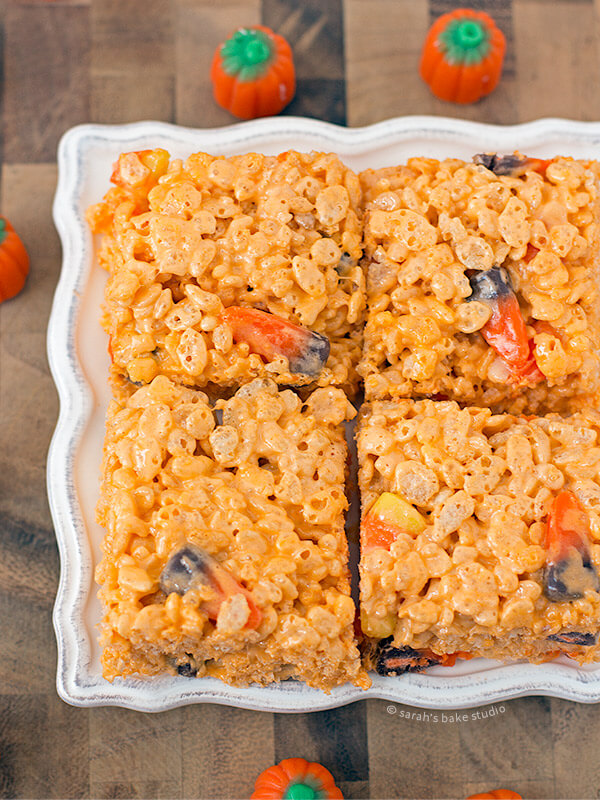 Candy Corn Rice Krispies Treats – your favorite marshmallow gooey, crispy, Rice Krispies Treats turned Halloween with the sweet addition of candy corn and candy corn marshmallows.