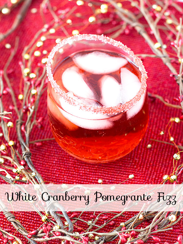 White Cranberry Pomegranate Fizz – a boozy three-ingredient holiday cocktail that will tickle your taste buds with Cascade Ice Cranberry Pomegranate Sparkling Water and white rum over ice.