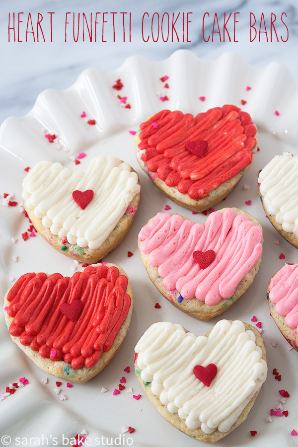 Heart Funfetti Cookie Cake Bars - delightfully chewy, sprinkle-filled sugar cookie cake bars topped with fluffy buttercream; show your love for your friends and family with these easy, customizable, delish heart treats.