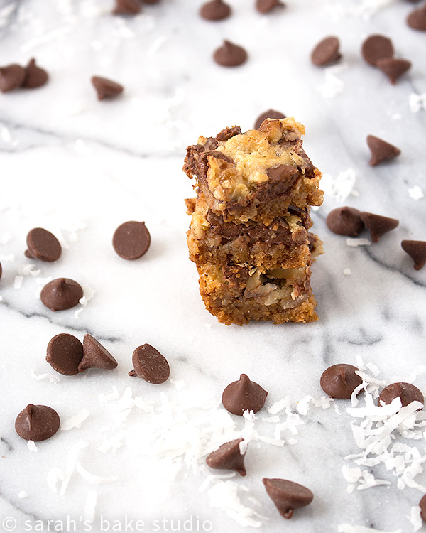 Hello Dolly Bars – crushed graham crackers, flaked coconut, and milk chocolate chips make these gooey bars positively scrumptious; they're a wicked good chocolate-y treat!