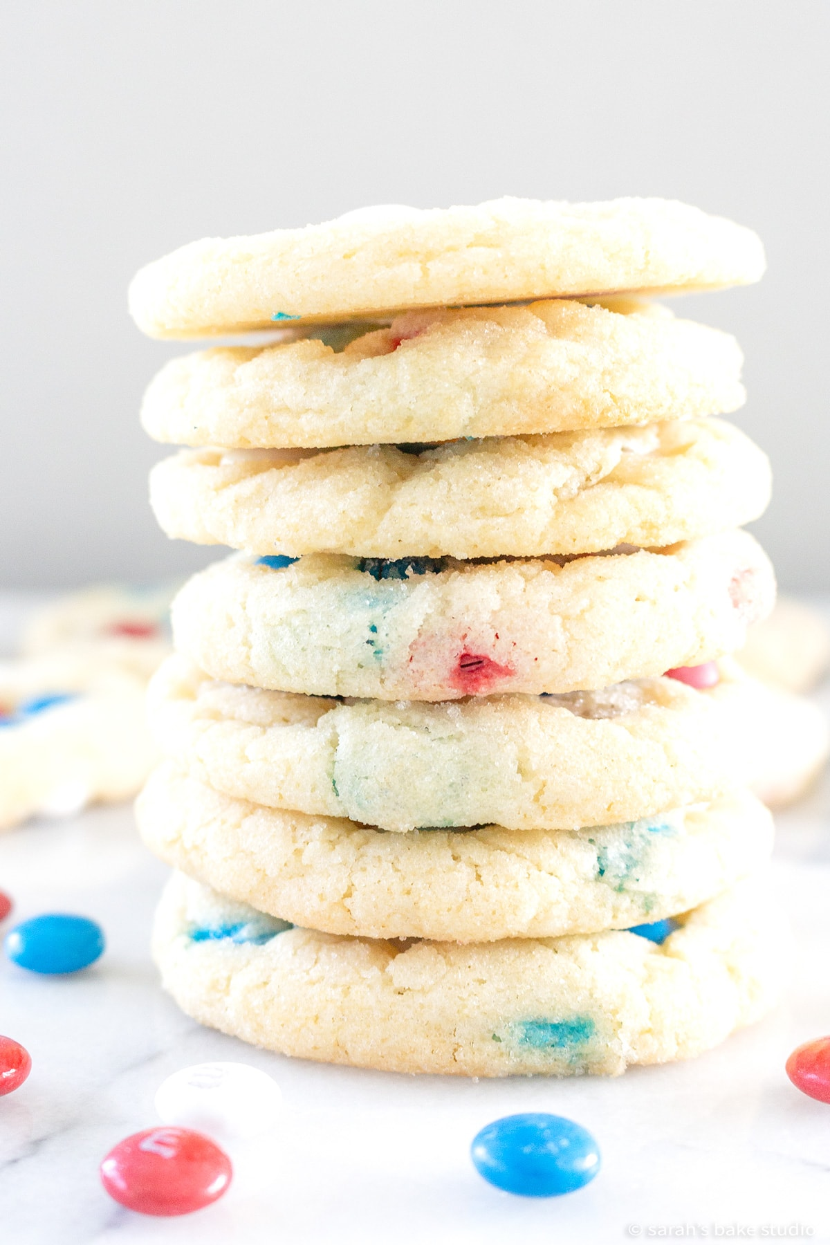 patriotic m&m cookies stacked into a tower.