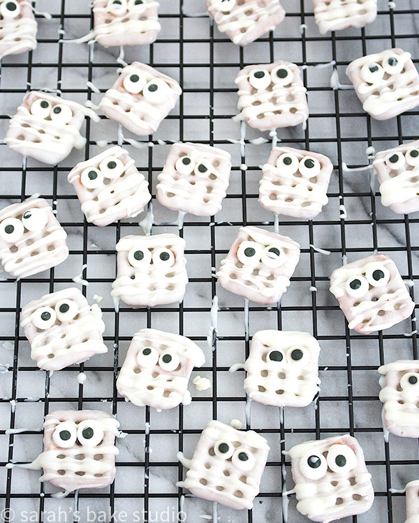 Mummy Pretzel Bites – white chocolate covered pretzel snaps with royal icing eyeballs that stare through to your soul; a sweet and salty, trouble-free, tasty, Halloween mummy treat.