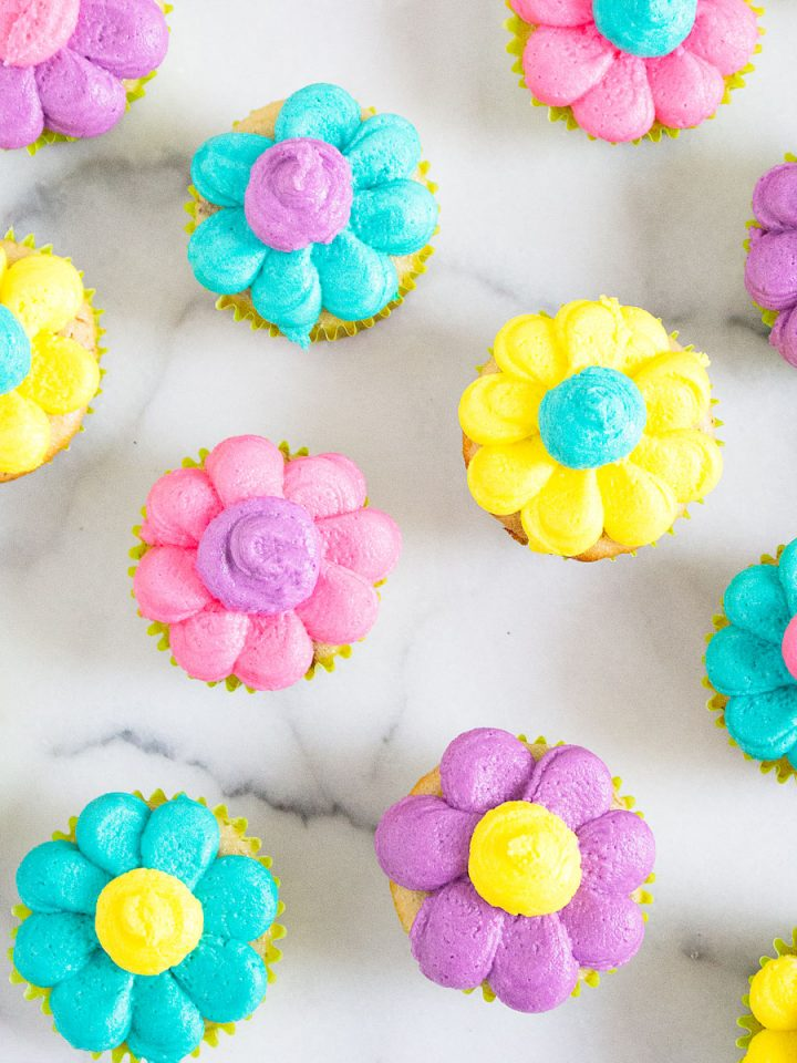 mini cupcakes with colorful buttercream frosting that resembles daisies