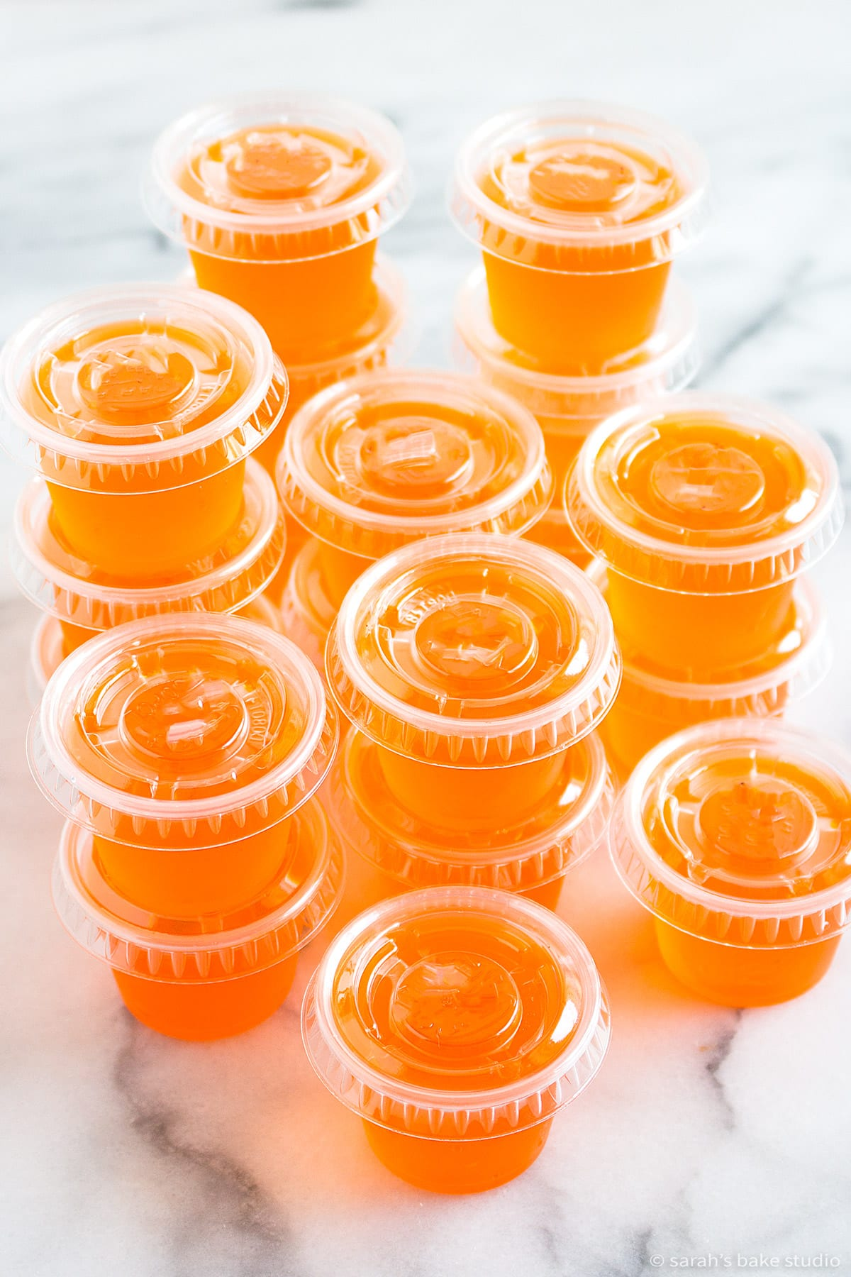 fuzzy navel jello shots in plastic one-ounce cups with lids