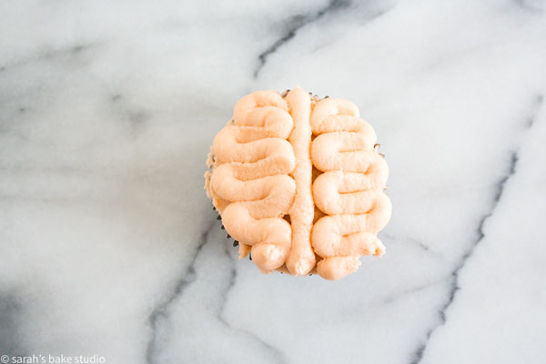 Brain Cupcakes – release your inner zombie with these creepy Halloween cupcakes piped with buttercream frosting to look like brains.