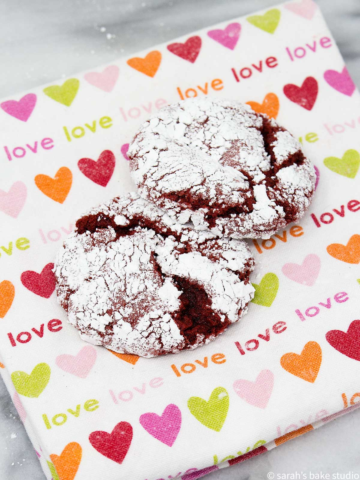 an up close look at red velvet crinkle cookies