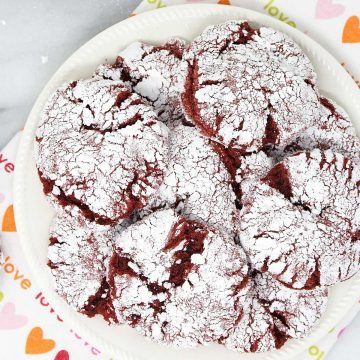 a collection of red velvet crinkle cookies on a plate