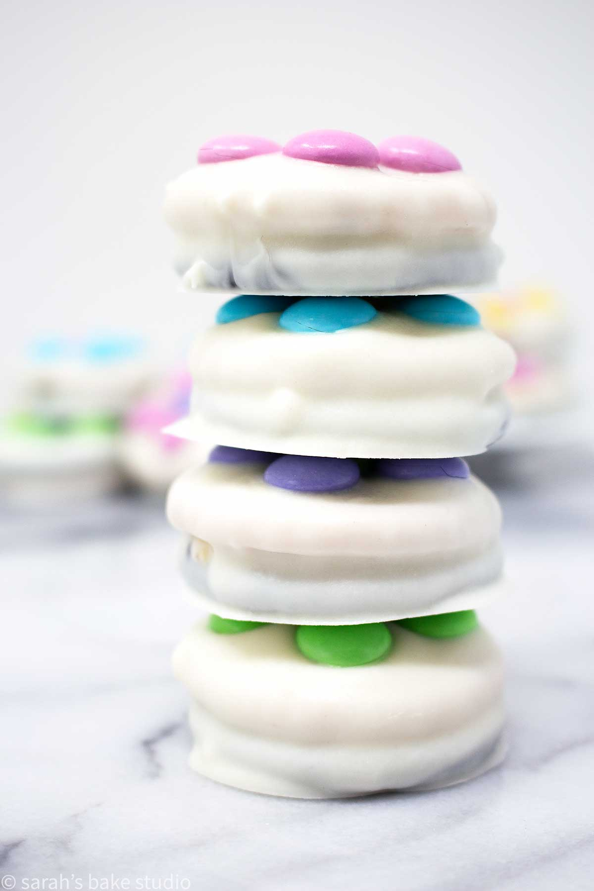 daisy white chocolate oreo cookies stacked into a tower