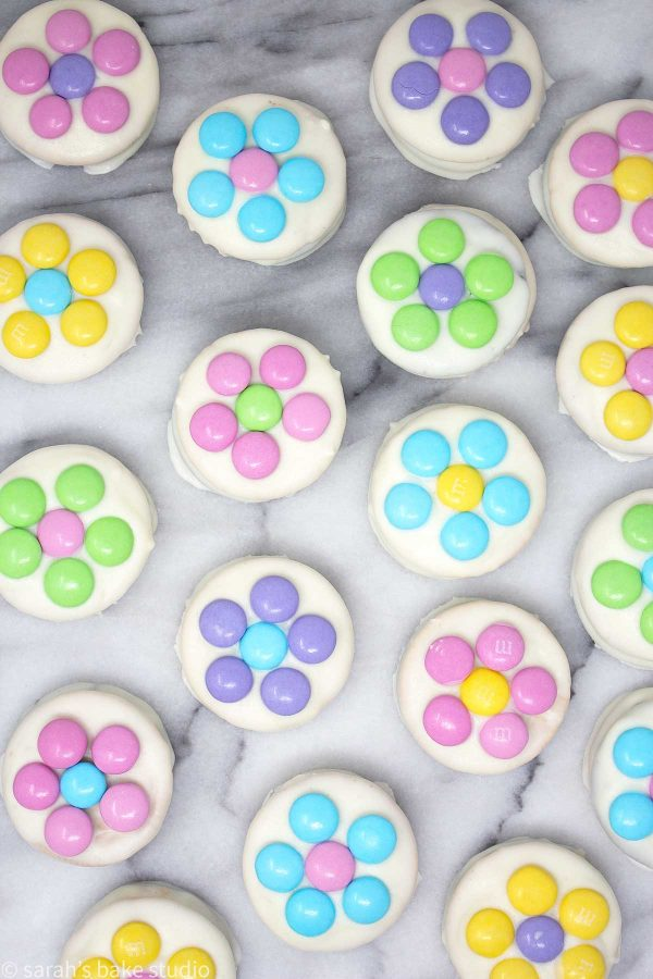 Daisy White Chocolate Oreos - your favorite flavor of Oreo cookies dipped into melted white chocolate and dressed to impress with pastel M&M's milk chocolate candies arranged into delightful daisy flowers.