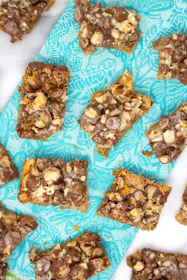Malted Hello Dolly Bars - a delish graham cracker crust dressed to the nines with milk chocolate chips, coconut flakes, walnut pieces, and chopped Whoppers; it's a scrumptious whopper of a dessert bar.
