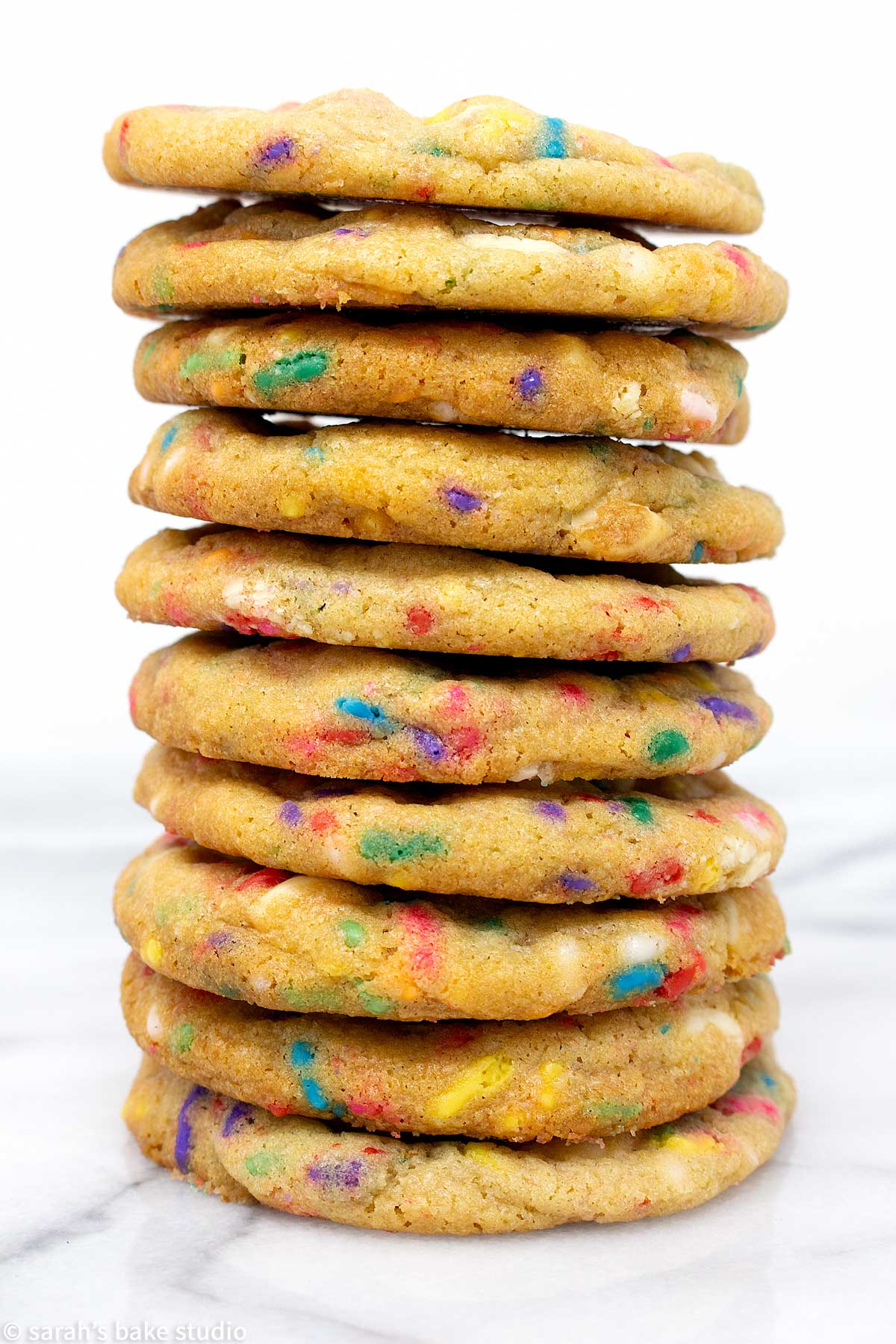 white chocolate confetti cookies stacked into a tower