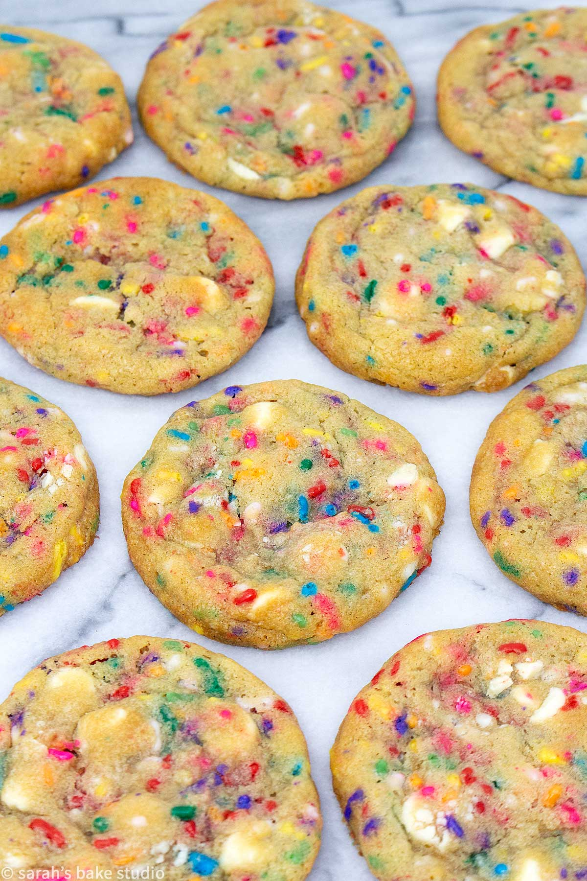 a close up of white chocolate confetti cookies