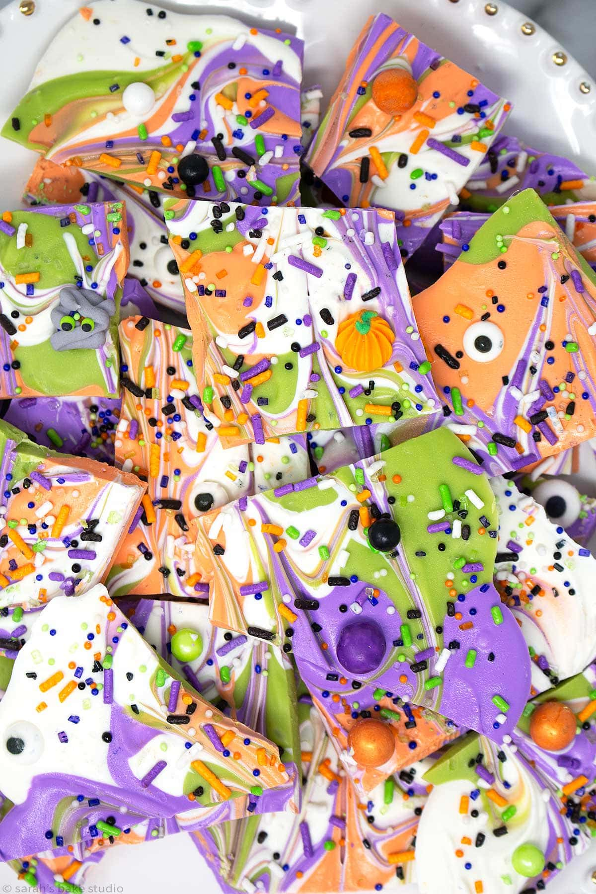 a plate stacked with monster mash Halloween bark.