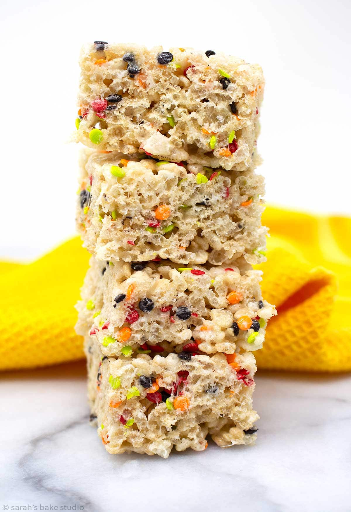 a stacked tower of fall harvest rice krispies treats.