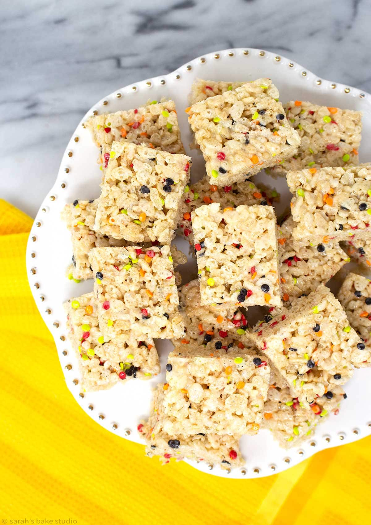 a white cake plate stacked with fall harvest rice krispies treats.