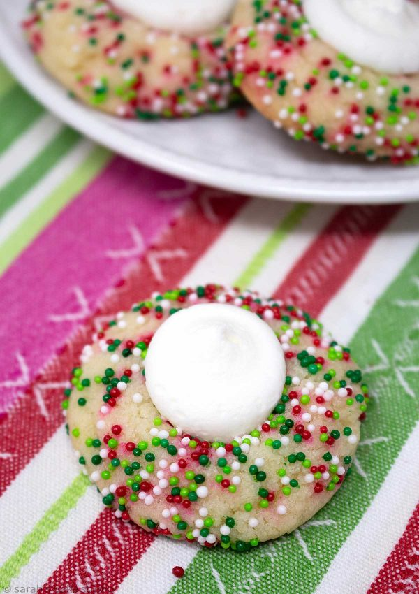 Buttercream Thumbprint Sugar Cookies – deliciously soft and chewy sugar cookies married to sweet and creamy buttercream and decked out with festive sprinkles, all bundled up in a no-stress cookie mix recipe.