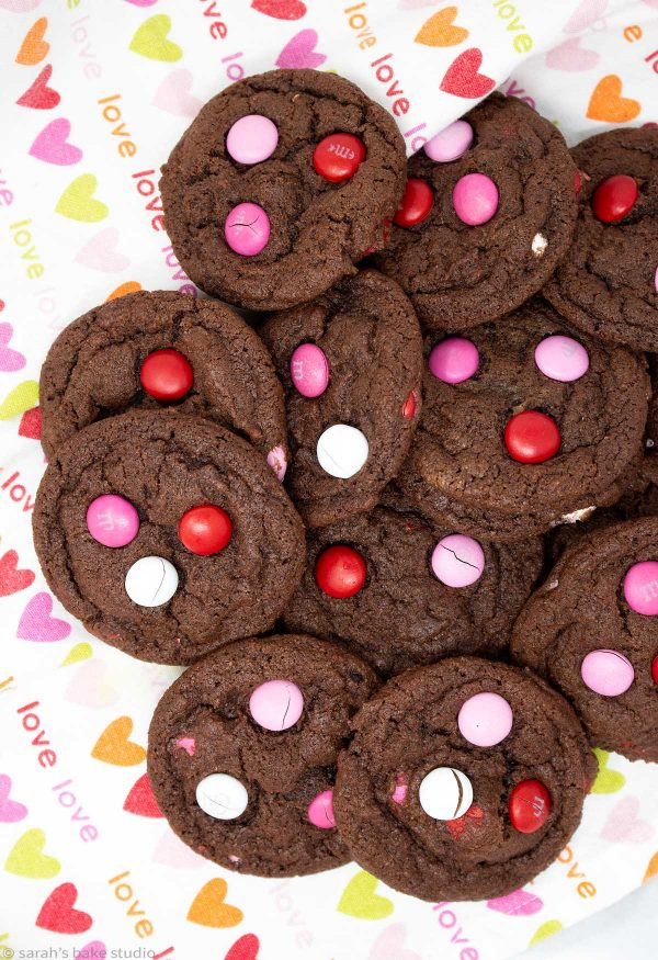 Valentine Chocolate Pudding M&M Cookies - perfectly chocolate with cocoa powder and chocolate fudge pudding mix plus festive Valentine's M&M's make these soft and chewy cookies positively spectacular!