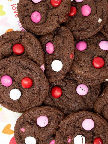 a bunch of chocolate pudding m&m cookies on a tea towel