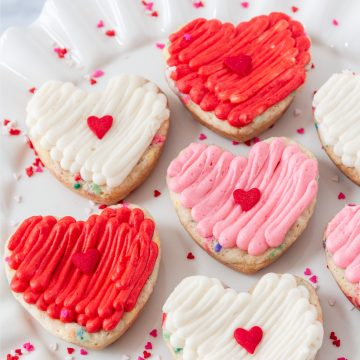 up close on a plate of heart funfetti cookie cake bars