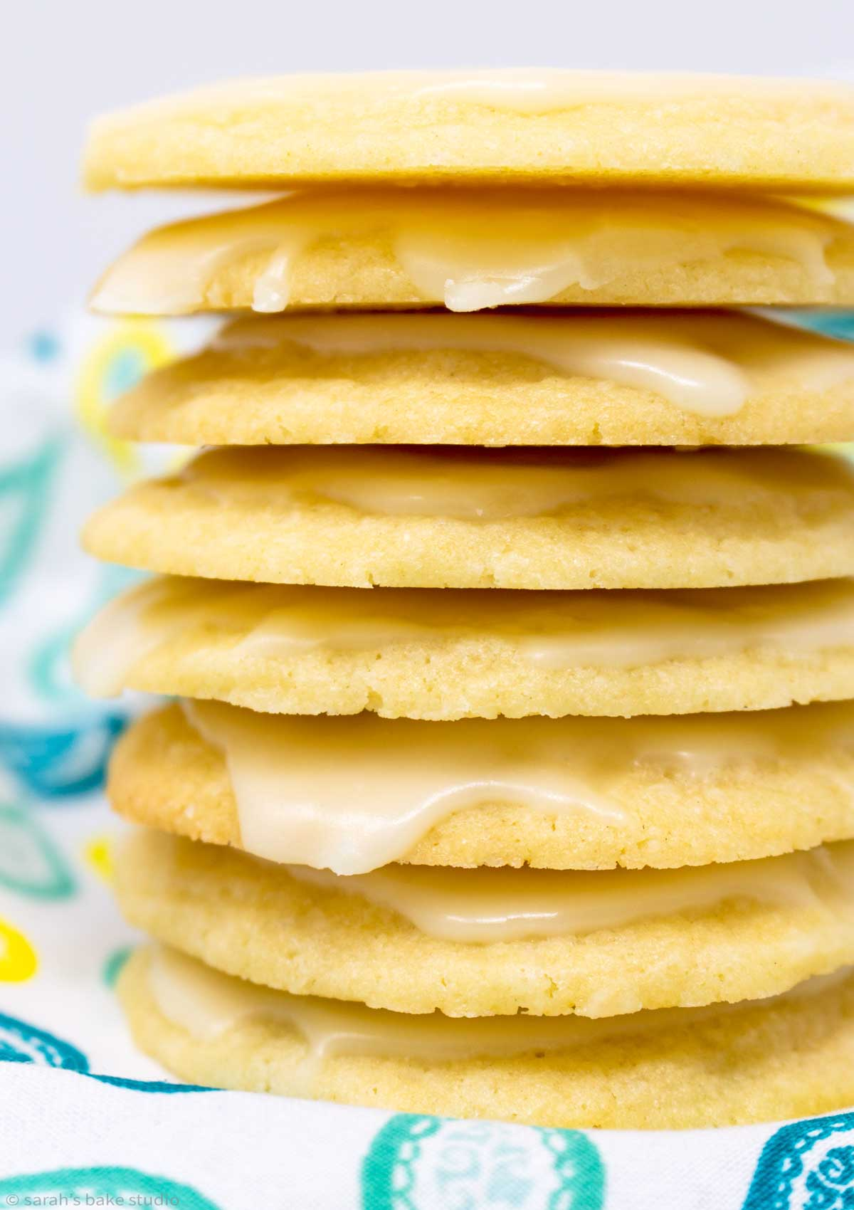 glazed limoncello cookies stacked into a tower.