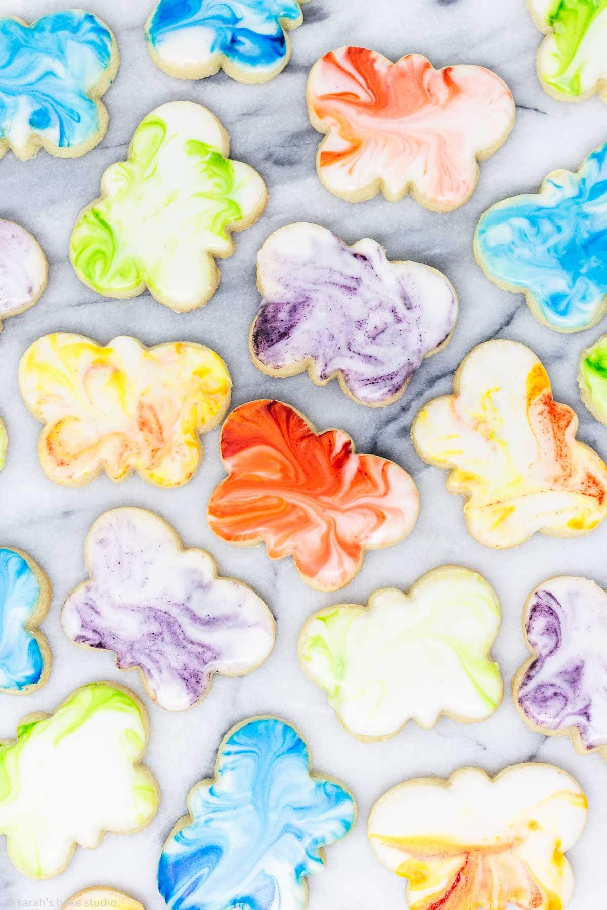 an overhead view of marbled butterfly sugar cookies