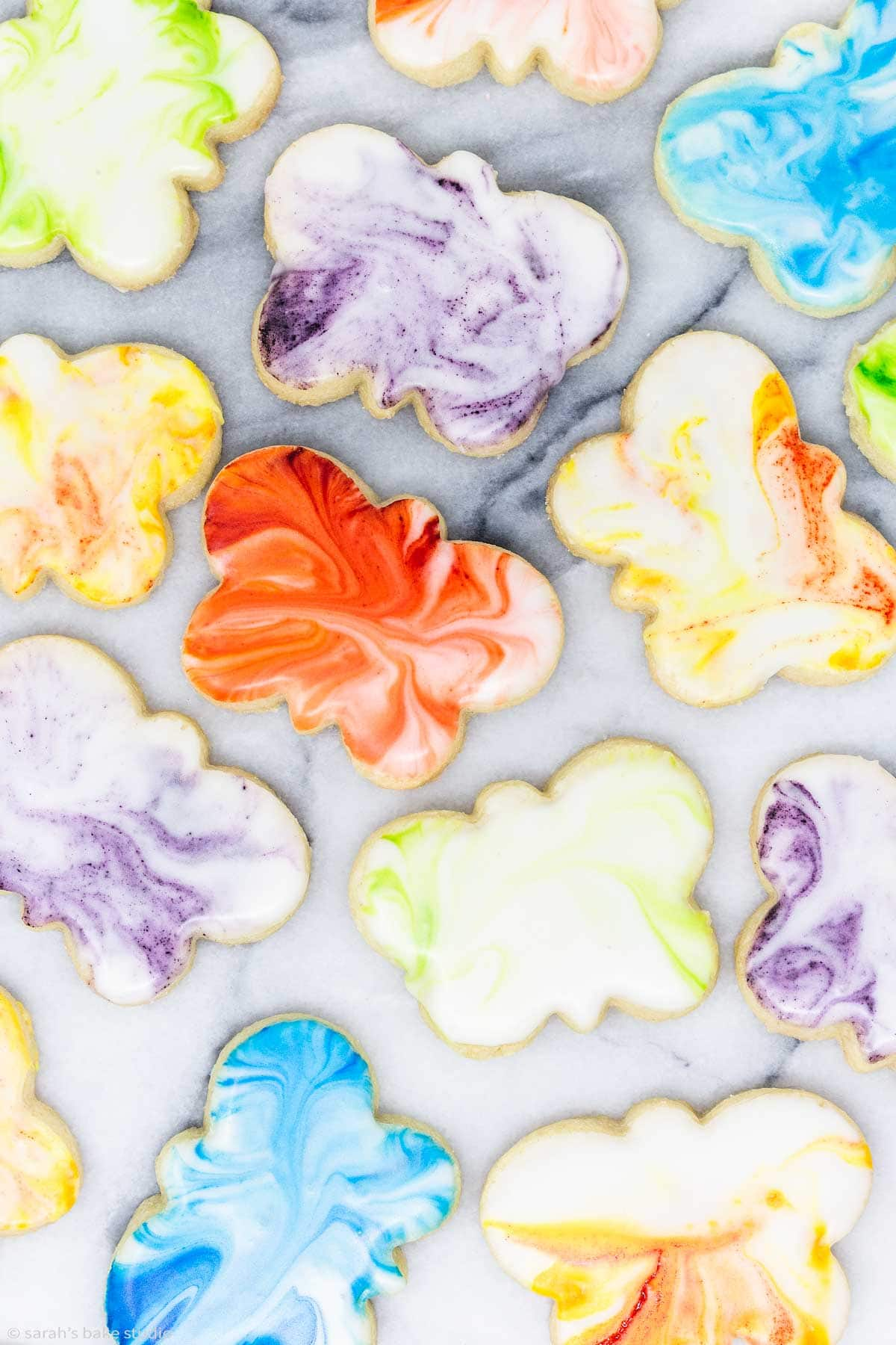 a close up of marbled butterfly sugar cookies