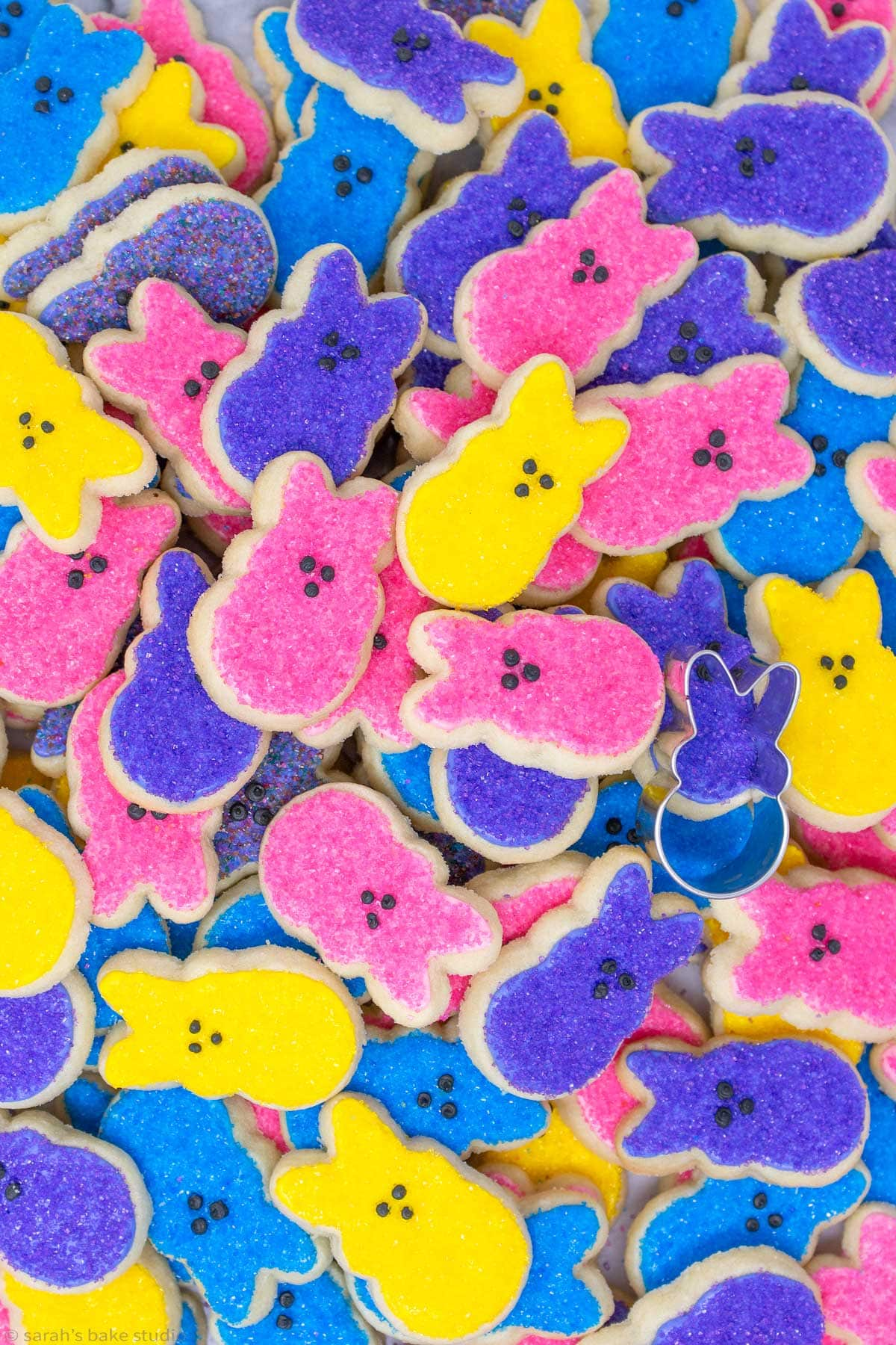 a pile of PEEPS Easter Bunny Sugar Cookies with the PEEPS cookie cutter