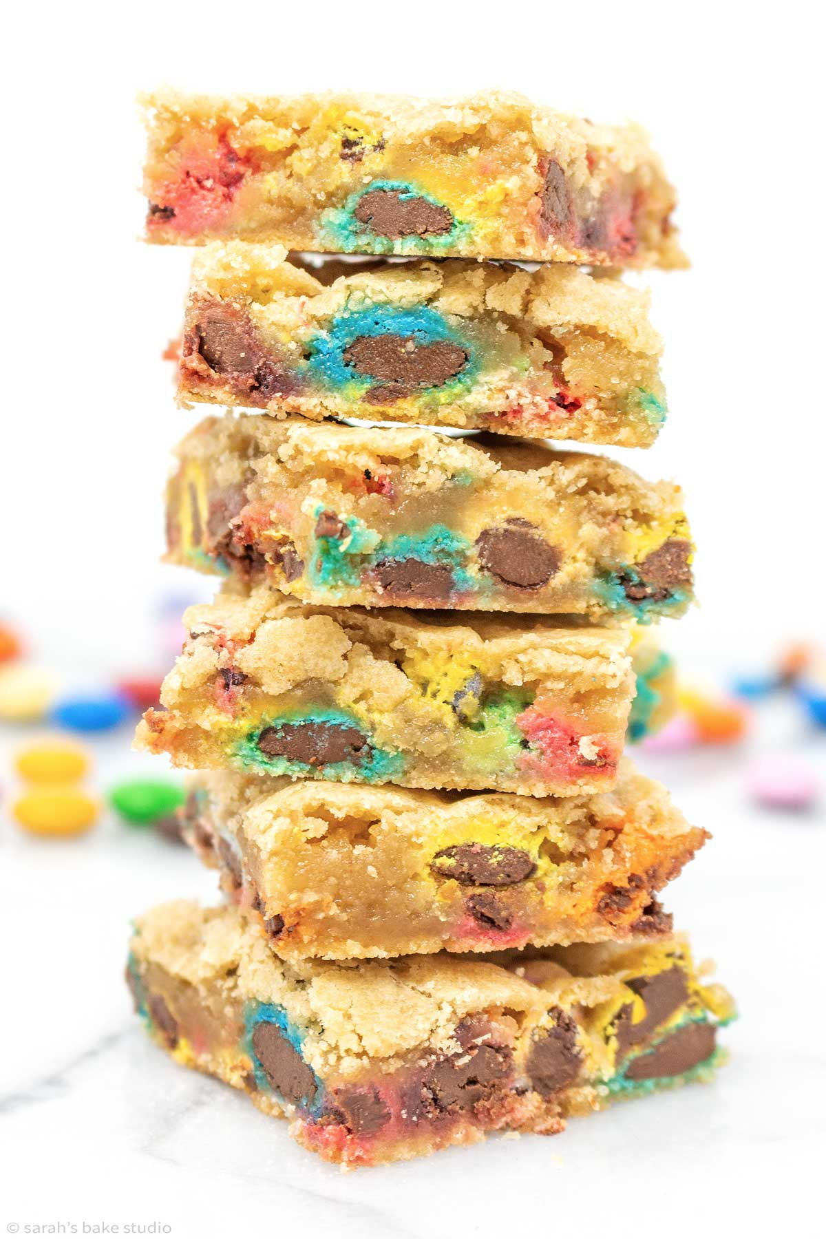 a stack of m&m cookie bars.