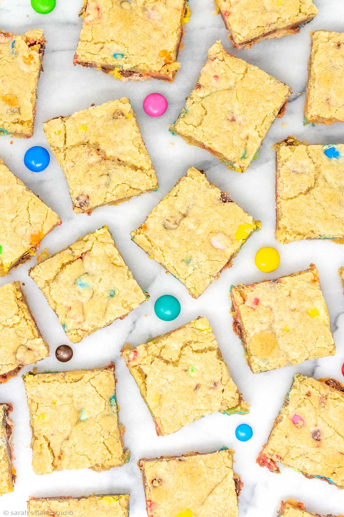 a flat-lay of m&m cookie bars.