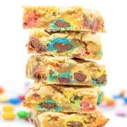 a stacked tower of m&m cookie bars.